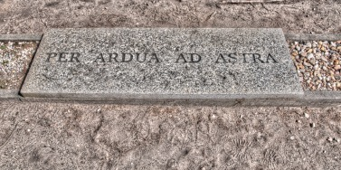 'Through soil to the stars', a modified Latin proverb 'Per aspera ad astra' meaning 'Through hardships to the stars'