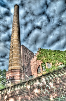 The factory buildings and chimney